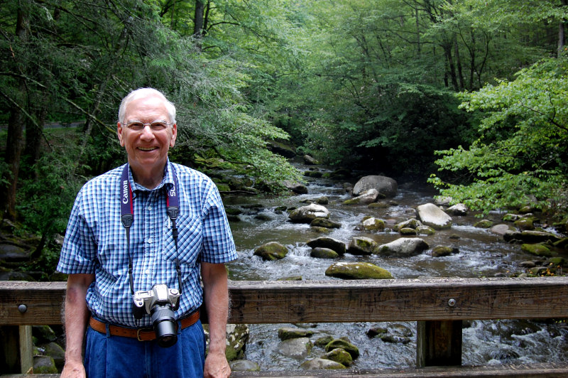 Wilmer Bloy on a mountain creek bridge
