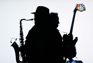 Clarence Clemons and Bruce Springsteen in silhouette