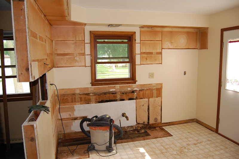kitchen space with cabinets and appliances removed