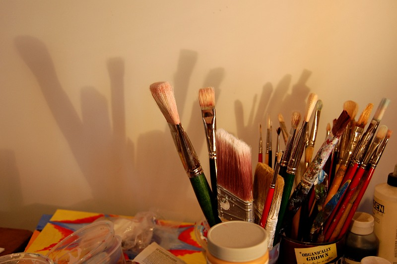 paint brushes and their shadow