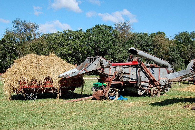 thresher with a cart of hay