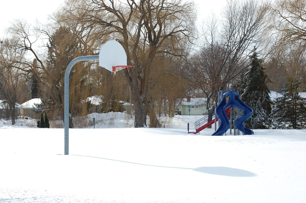 basketball court covered in snow