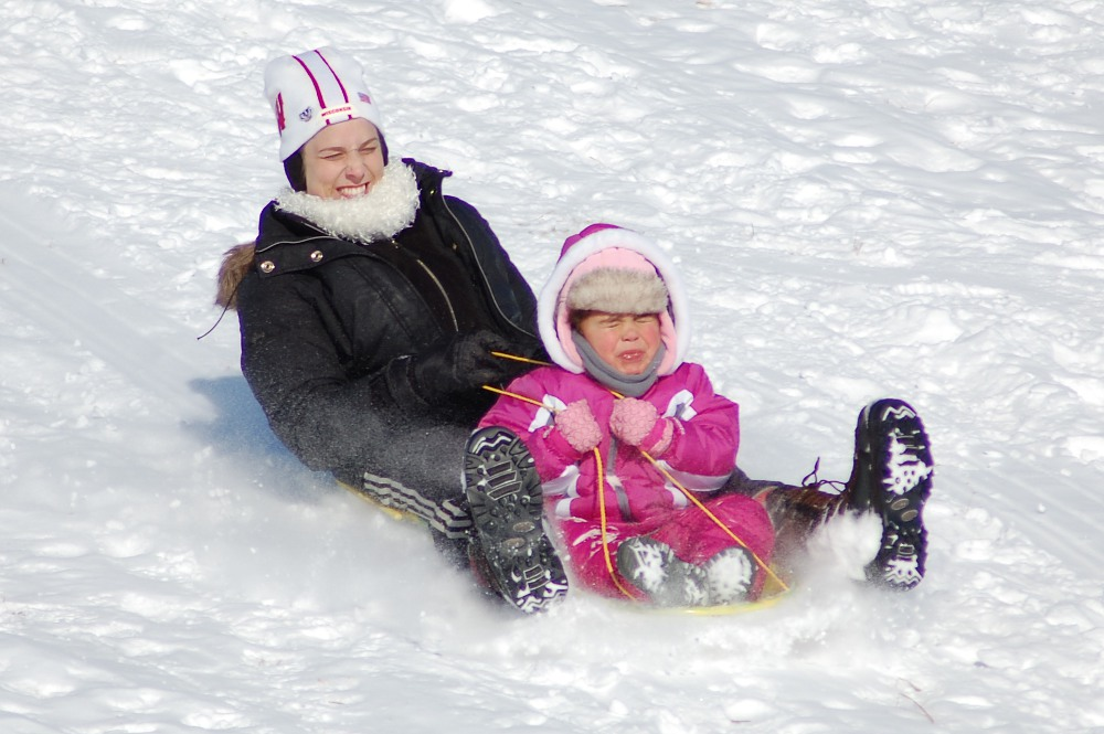 sledding down a hill