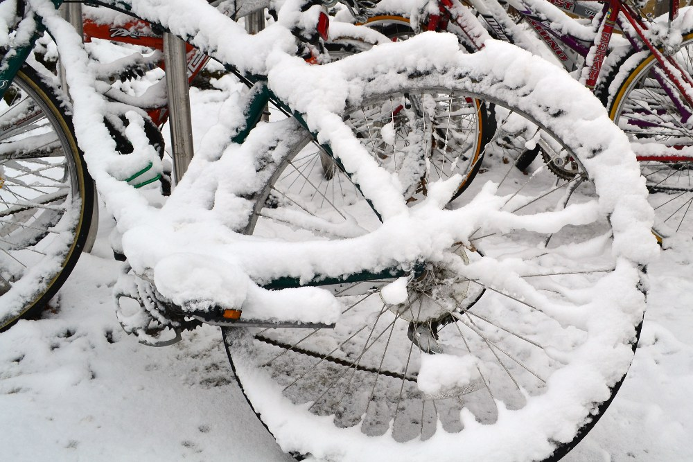 snow covered bicycle wheel