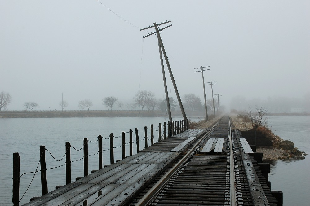 Railroad tracks heading into fog