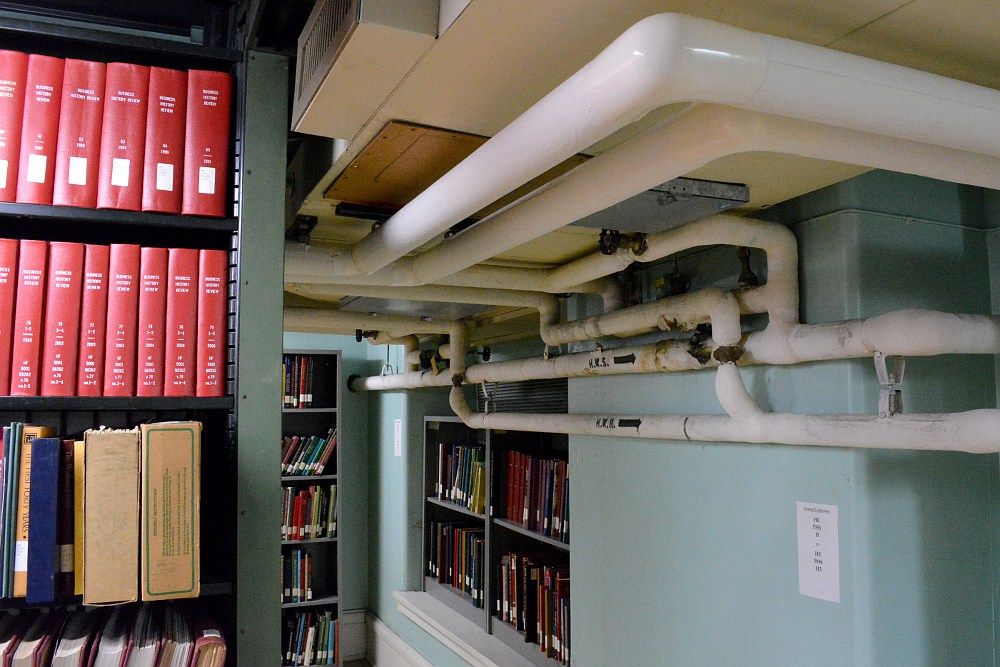 Pipes ductwork and bookshelves