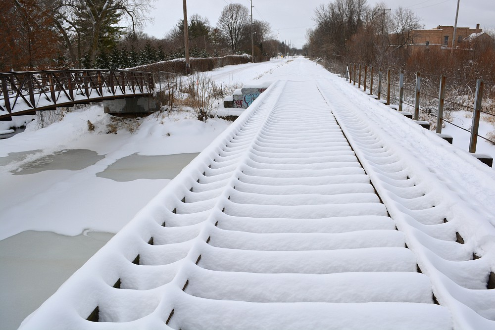 Fresh snow covering a railroad bridge