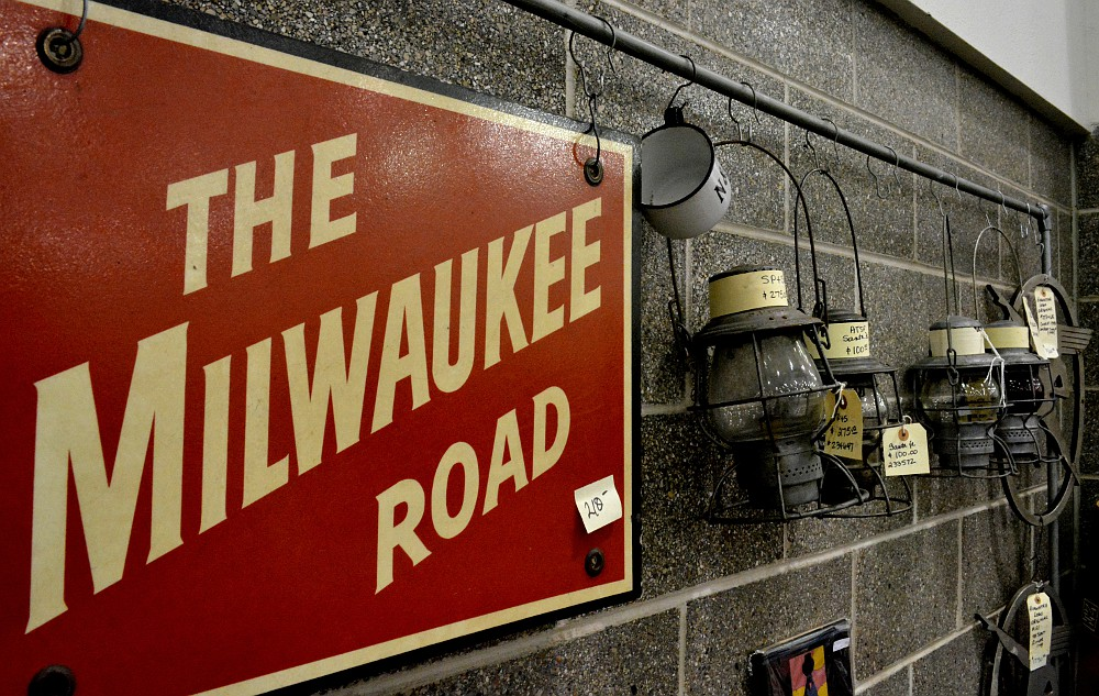 Milwaukee Road sign and railroad lanterns