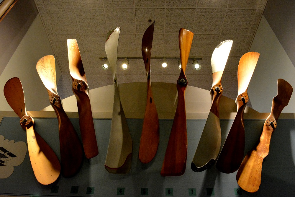 airplane propellers hanging on a wall