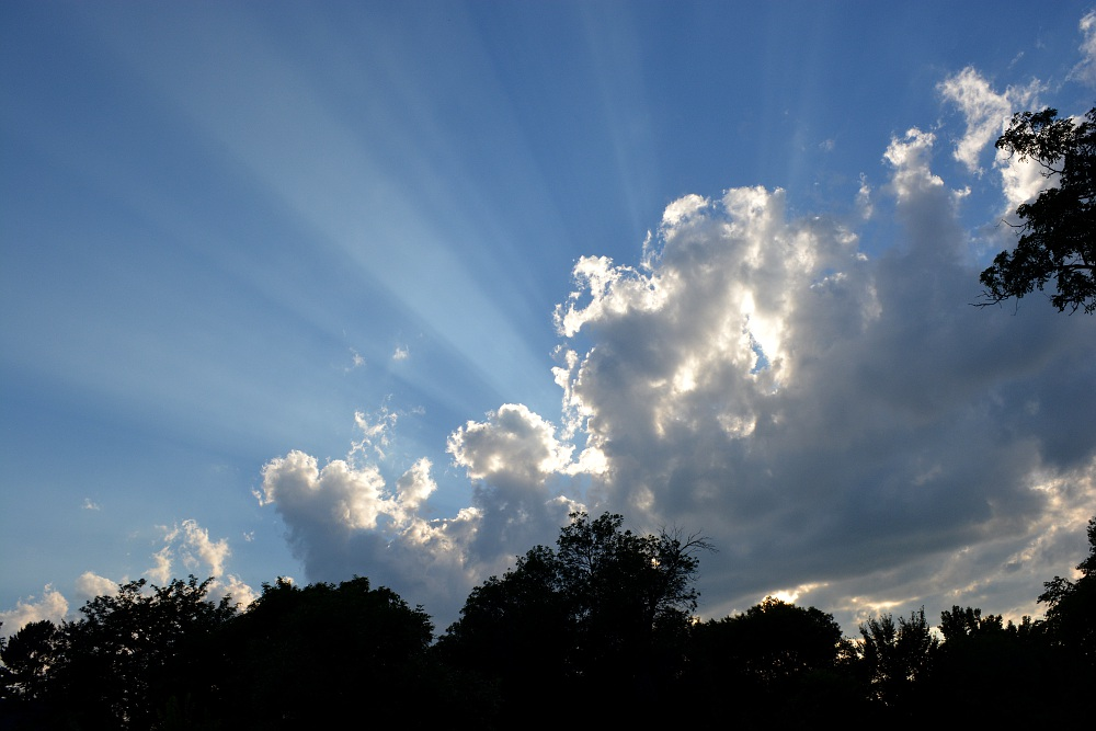 sunbeams shinning through clouds