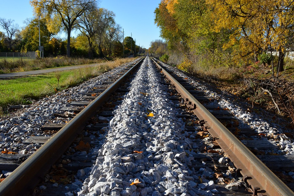 Railroad tracks with fresh ballast between the rails