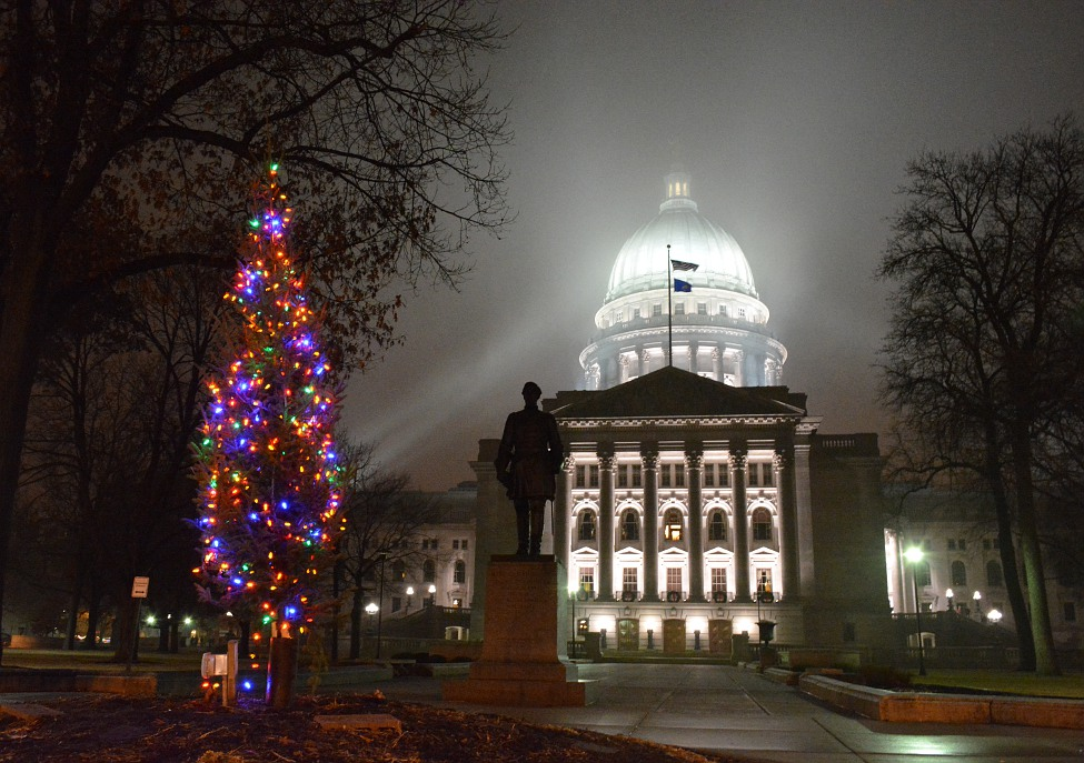Lit Christmas tree in front of a foggy Capitol