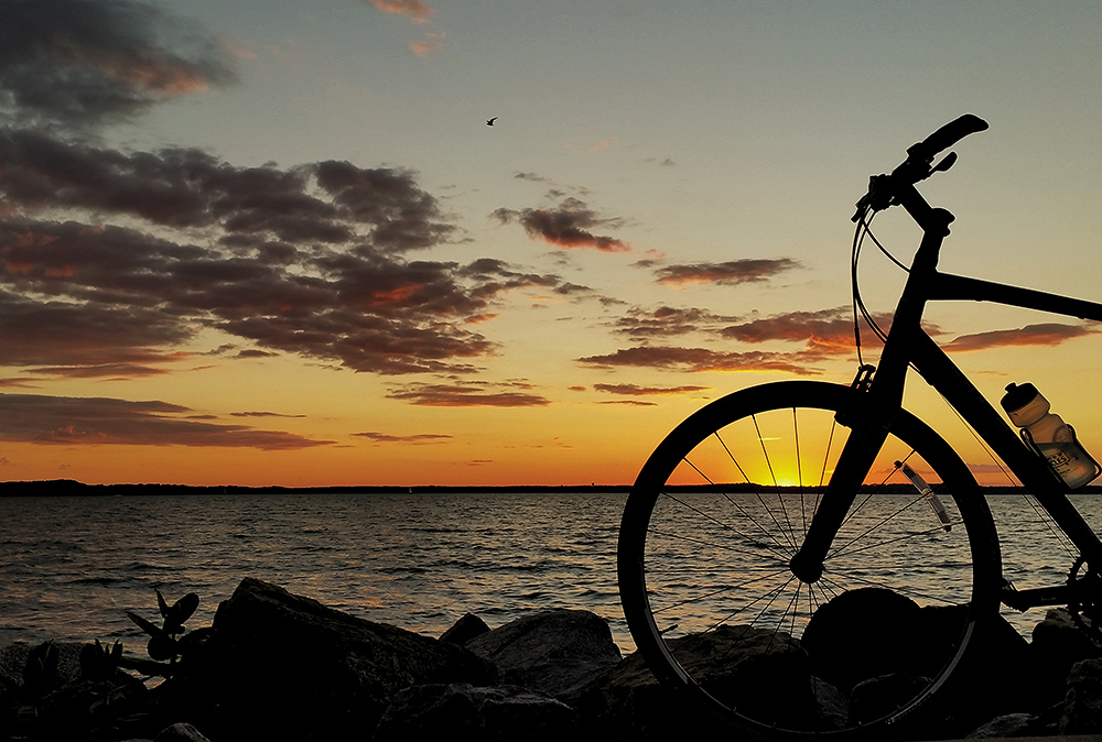 Lakeside sunset with bicycle silhouette