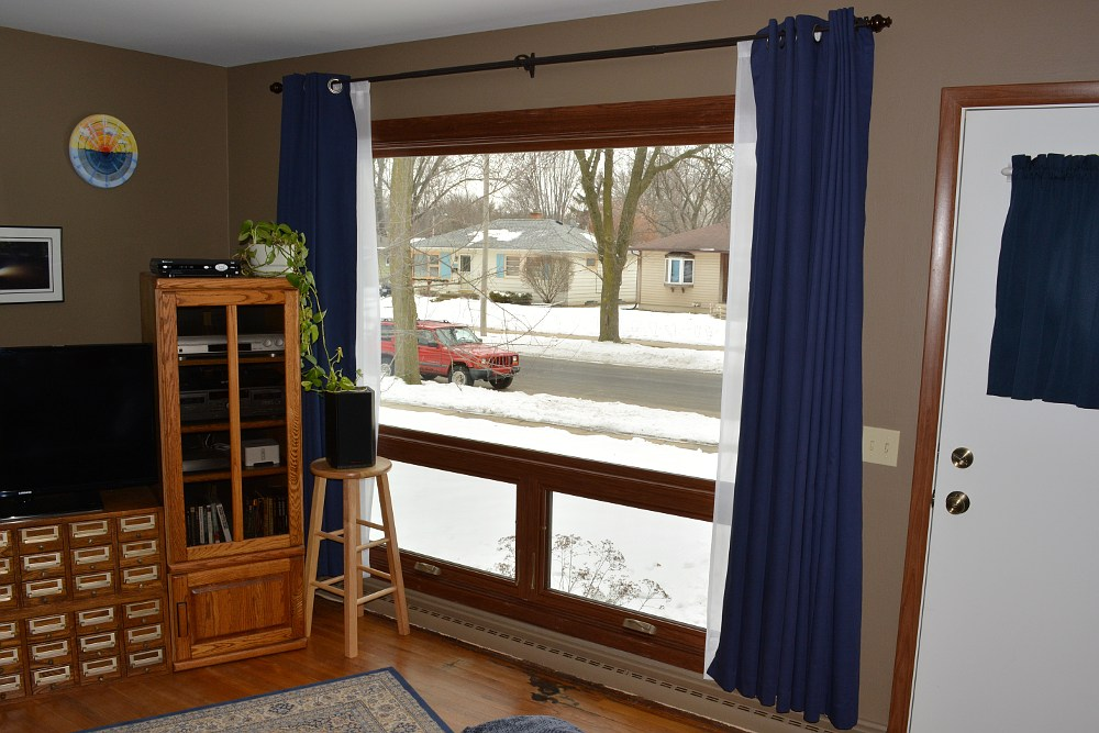 New picture window with window treatments