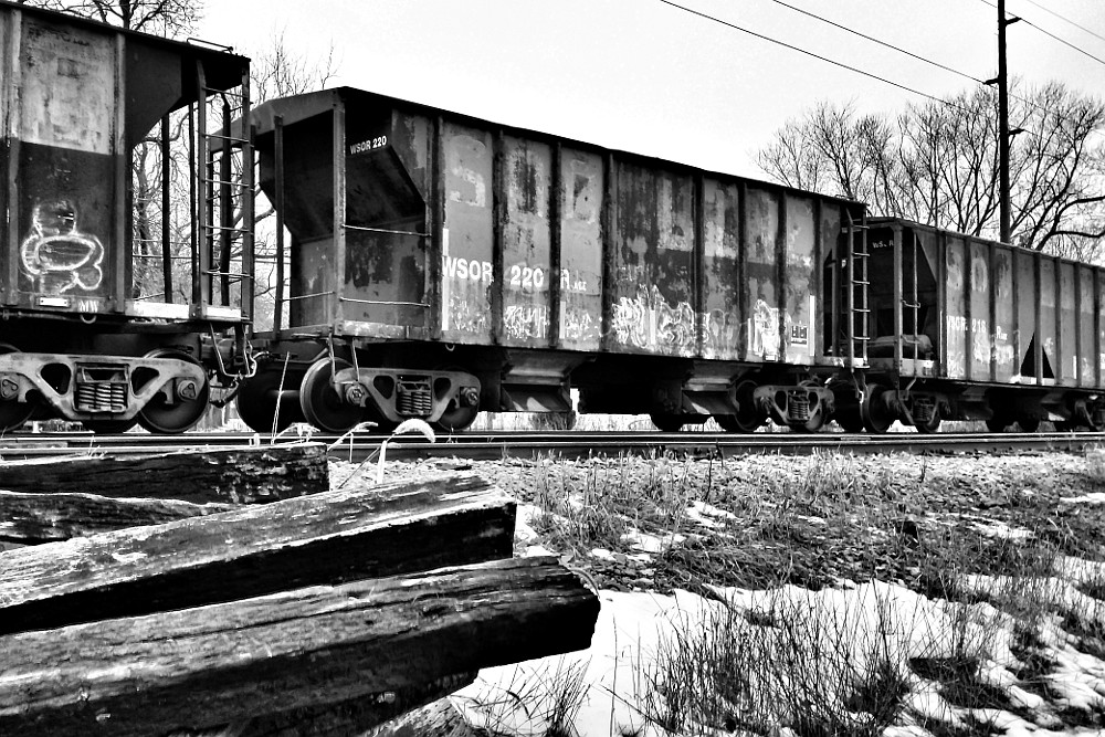 former Soo Line hopper cars sitting on a railroad siding