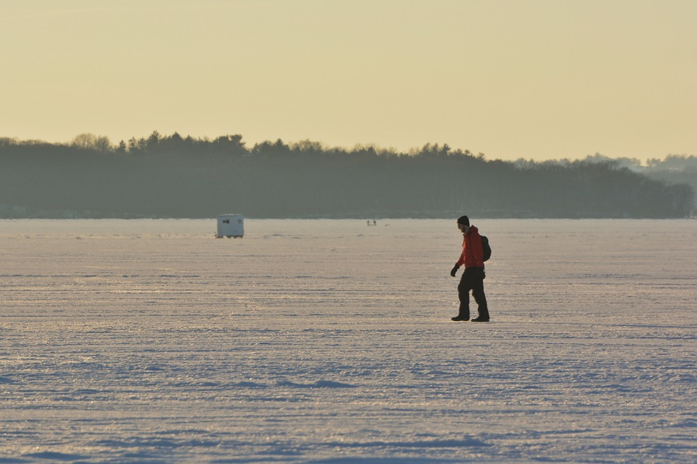Man walks across a frozen lake