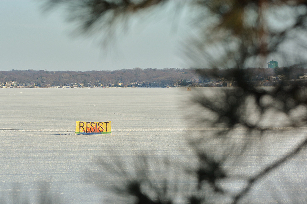 Resist sign on a frozen lake