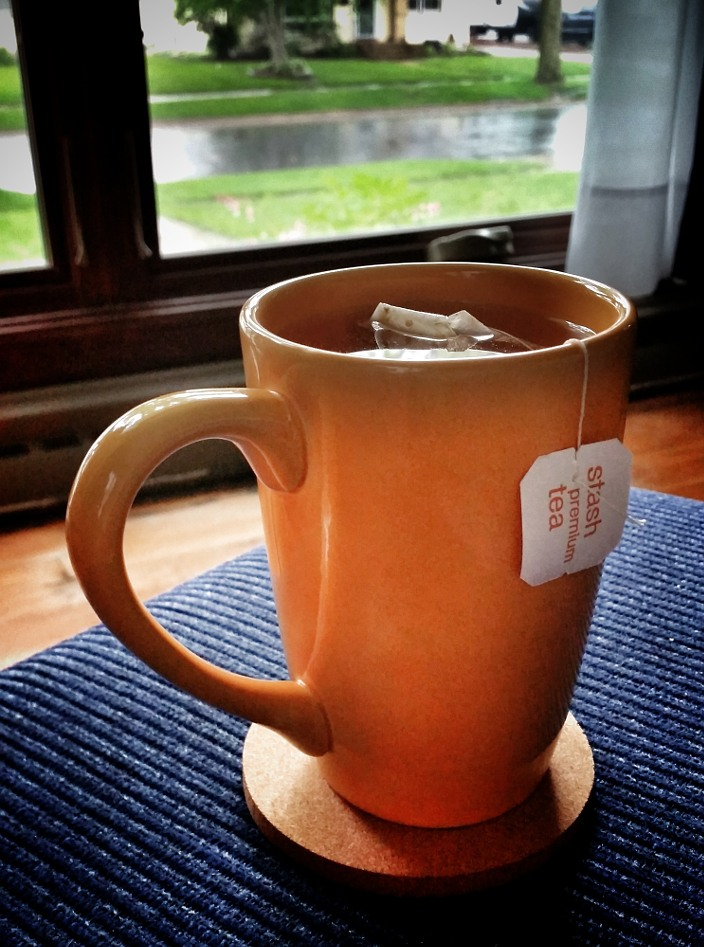 Mug with tea in front of a window