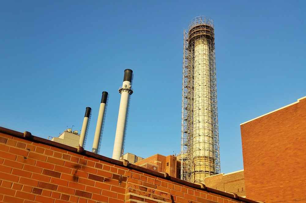 Large smokestack surrounded by scaffolding