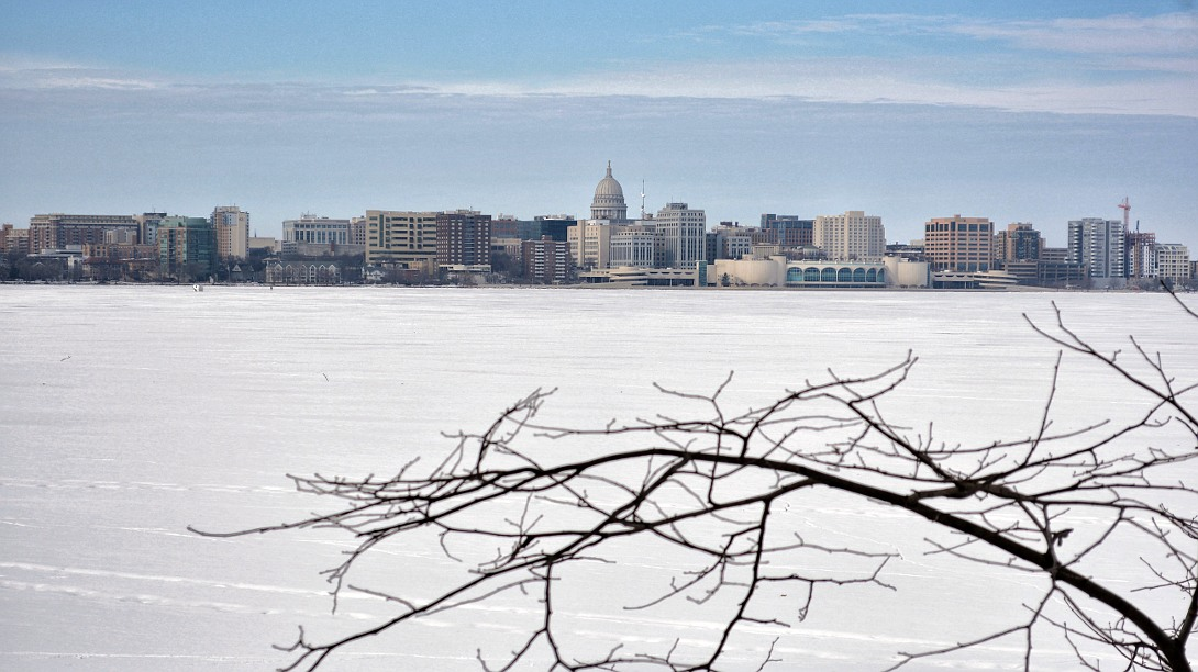 Downtown Madison Wisconsin skyline behind frozen Lake Monona