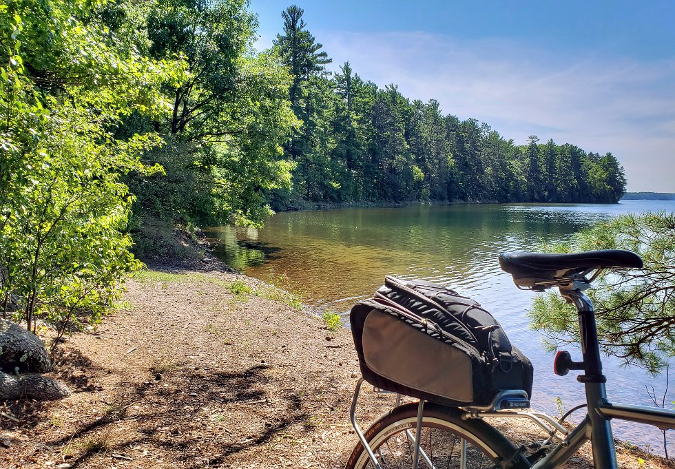 Bicycle parked along a lake shore