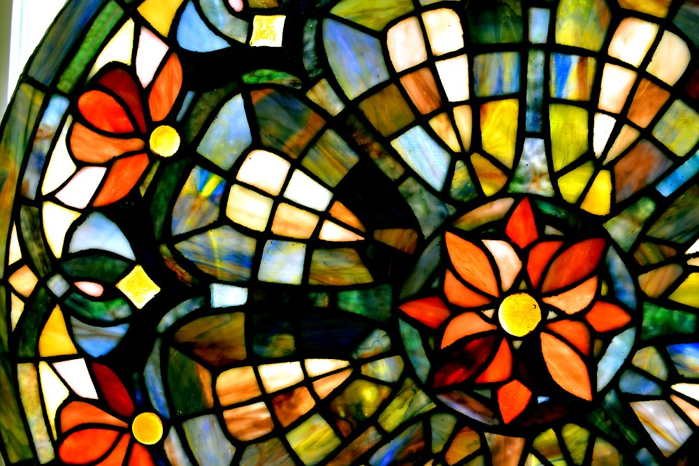 close up of a multi-colored stained glass window